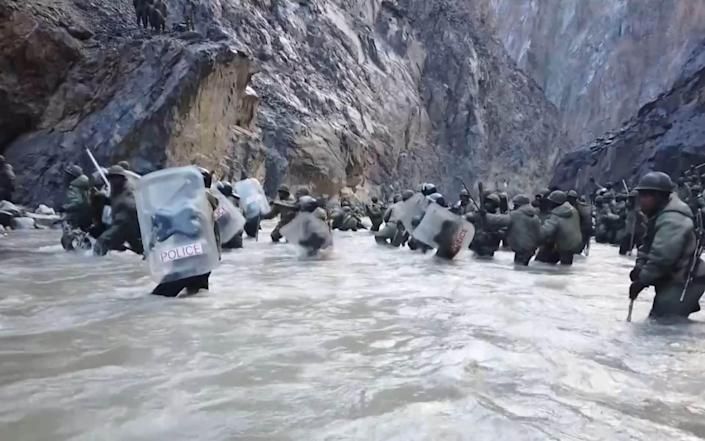 Indian soldiers crossing a river in the Galwan Valley in June last year, according to footage shown on Chinese state TV - GETTY IMAGES
