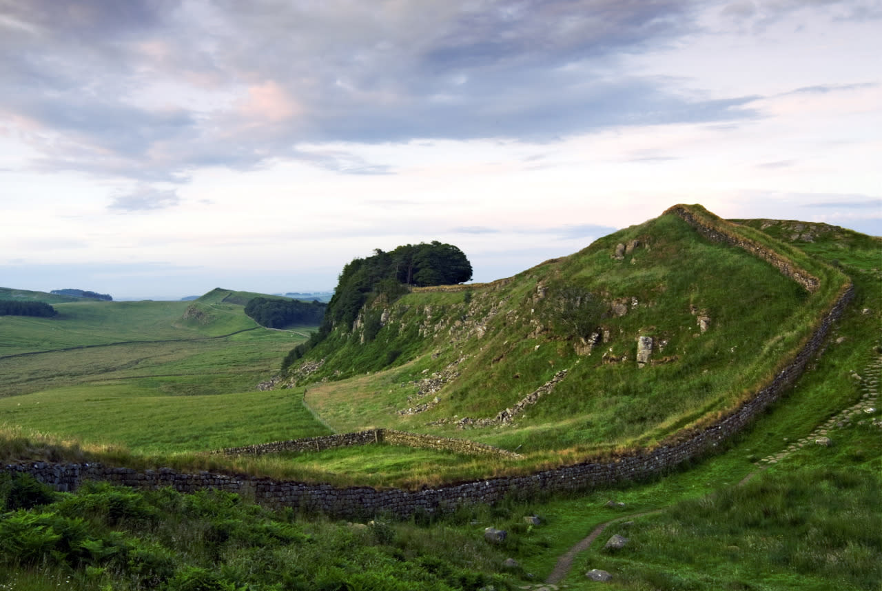 <p>Listed as a designated UNESCO World Heritage Site and titled the most popular tourist attraction in Northern England, Hadrian's Wall most definitely deserves a place on this list! </p><p>With history dating back to 122AD, part of the wall still stands and the adjoining Hadrian's Wall Path can be followed on foot, although visitors are encouraged to attempt the historic national trail in the summer months only!</p><p><br /></p>