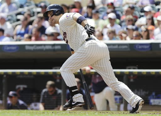 Minnesota Twins' Josh Willingham watches his RBI single off Chicago White Sox pitcher Dylan Axelrod during the first inning of a baseball game, Wednesday, May 15, 2013, in Minneapolis. (AP Photo/Jim Mone)