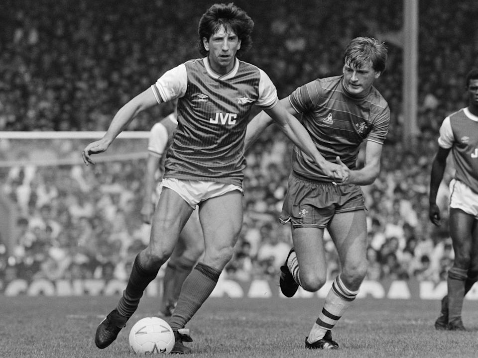 Holding off Chelsea's Nigel Spackman during a London derby at Highbury in 1984 (Getty)