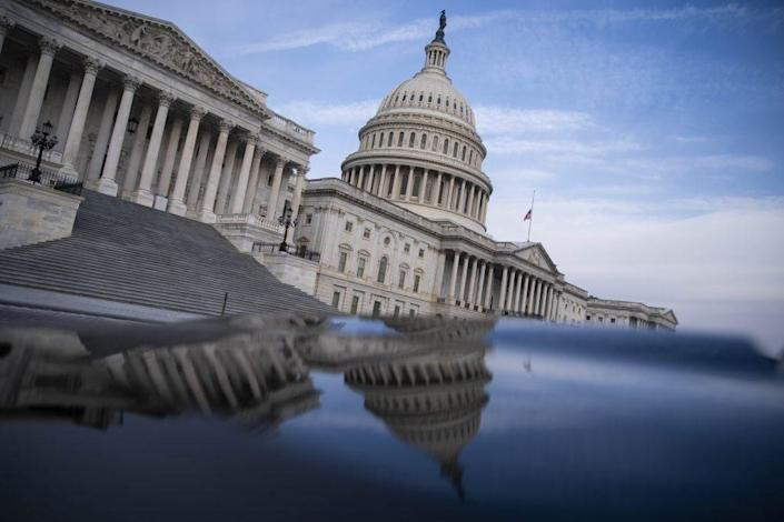 The U.S. Capitol building is reflected on the hood of a car on February 10, 2021 in Washington, DC. (Photo by Sarah Silbiger/Getty Images)