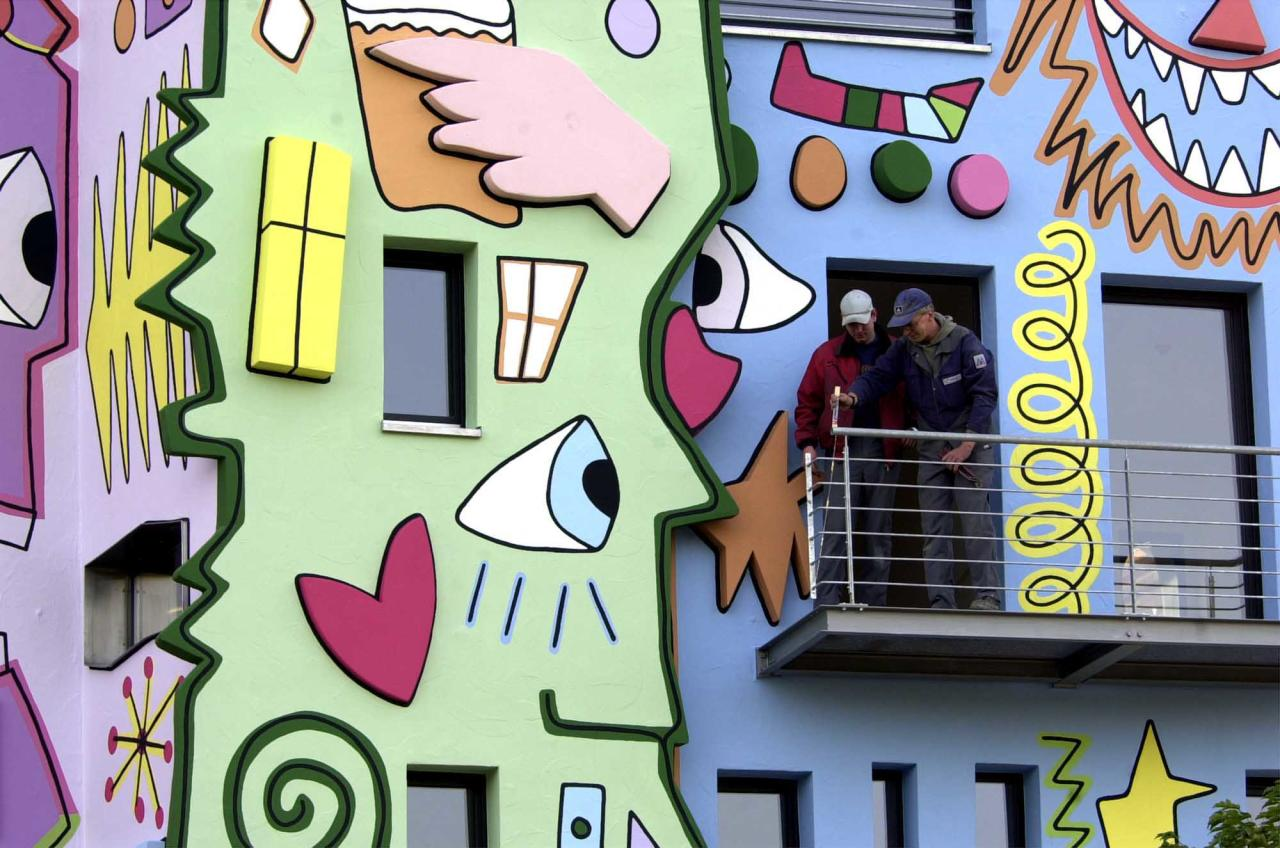 Two worker stand on a balcony of the Rizzi-House in Braunschweig, northern Germany, designed by U.S. pop artist James Rizzi, on Tuesday, Oct. 30, 2001.  The house with the colourful paintings will be opened in spring 2002. A German finance-service company will have their offices in the house which is financed by a private person. (AP Photo/Fabian Bimmer)