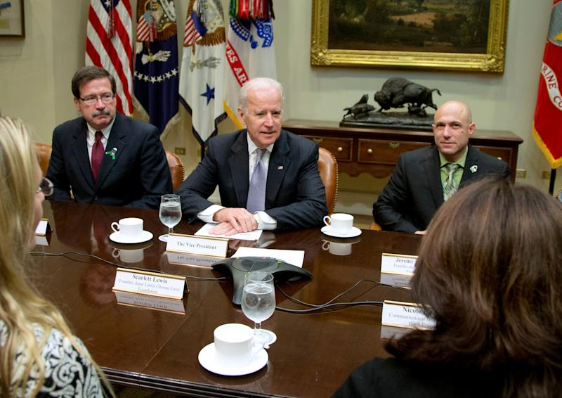 Vice President Joe Biden met with Newtown shooting family members, including Jeremy Richman (right), at the White House in December 2013 to discuss efforts to increase access to mental health services. (AP Photo/Carolyn Kaster) (Photo: ASSOCIATED PRESS)