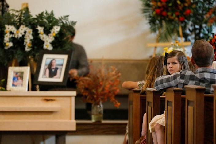 Relatives of Christina Marie Langford Johnson, who was killed by unknown assailants, attend her funeral service before a burial at the cemetery in LeBaron, Chihuahua