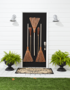 "<p>If you're planning on wearing a <a href=""https://www.countryliving.com/diy-crafts/g28304812/diy-witch-costume/"" rel=""nofollow noopener"" target=""_blank"" data-ylk=""slk:witch costume"" class=""link rapid-noclick-resp"">witch costume</a> this year, why not decorate your door with broomsticks? Matching your costume to your decorations is always a good idea.</p><p><strong>Make the Broomstick Door:</strong> Drill a small hole in the handle of two large outdoor brooms. Hammer five small nails in front door. Hang two brooms, right sides up, through holes. Hang a third large broom and two small ""witches brooms"" by threading the bristles over the remaining three nails. Add black plastic Grecian urn planters and ""Spirit Board"" doormat.</p><p><a class=""link rapid-noclick-resp"" href=""https://www.amazon.com/Better-Broom-Outdoor-Garden-Rake/dp/B07FC65ZJC/ref=sr_1_1?tag=syn-yahoo-20&ascsubtag=%5Bartid%7C10050.g.22350299%5Bsrc%7Cyahoo-us"" rel=""nofollow noopener"" target=""_blank"" data-ylk=""slk:SHOP BROOMS"">SHOP BROOMS</a></p>"