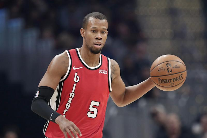 Portland Trail Blazers' Rodney Hood drives against the Cleveland Cavaliers in the first half of an NBA basketball game, Saturday, Nov. 23, 2019, in Cleveland. (AP Photo/Tony Dejak)