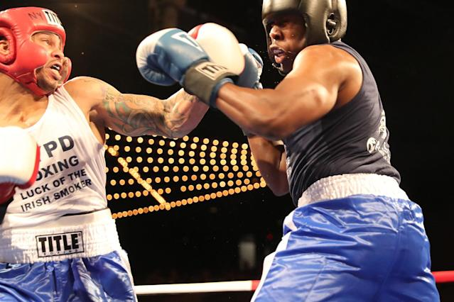 <p>Emmanuel Etienne, left, lands a punch off Jamaal Spence in the ring during the NYPD Boxing Championships at the Theater at Madison Square Garden on June 8, 2017. (Photo: Gordon Donovan/Yahoo News) </p>