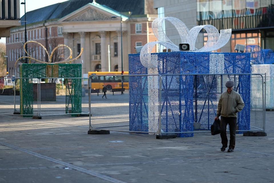 The illuminated display of four hollowed out gifts has been erected in Derby city centre in a bid to attract visitors over the festive period (Picture: SWNS)