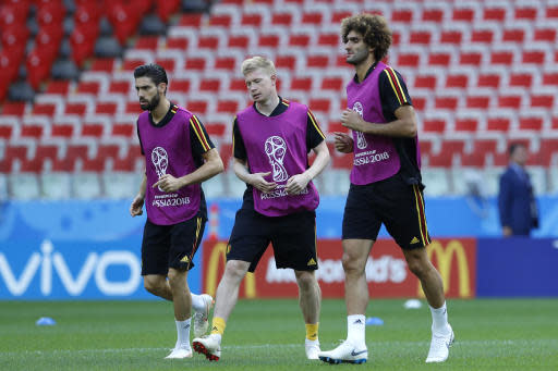 Belgium's Yannick Carrasco, left, Belgium's Kevin De Bruyne, center, and Belgium's Marouane Fellaini warm up during Belgium's official training ahead of the group G match between Belgium and Tunisia at the 2018 soccer World Cup in the Spartak Stadium in Moscow, Russia, Friday, June 22, 2018. (AP Photo/Hassan Ammar)