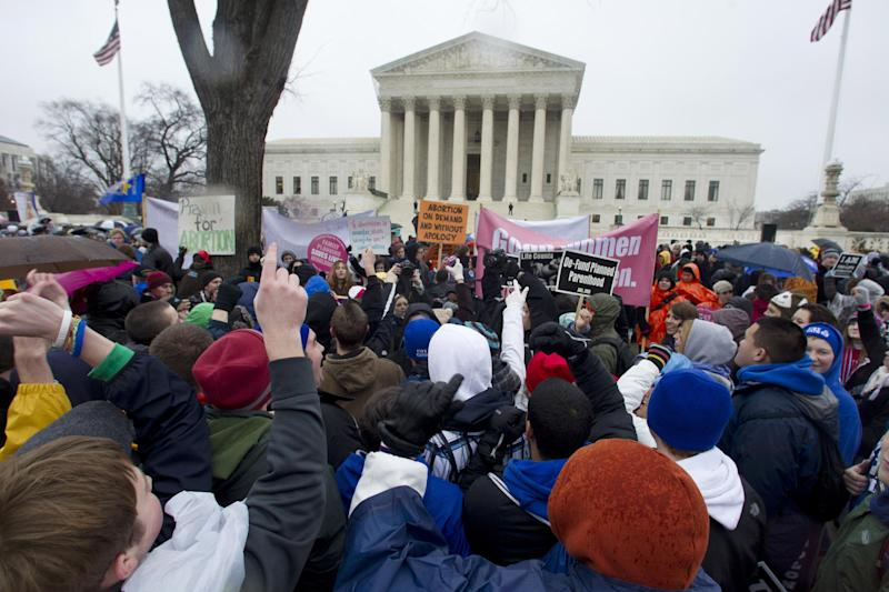 FILE - In this Jan. 23, 2012, file photo, anti-abortion and abortion rights supporters stand face to face in front of the Supreme Court in Washington, during the annual March For Life rally. Having no immediate hope to overturn the U.S. Supreme Court's Roe v. Wade decision that legalized abortion nationwide, Republicans in capitols around the country have accelerated their push for legislative restrictions on the procedure, and Democrats say they'll make the GOP pay in coming elections. (AP Photo/Manuel Balce Ceneta, File)