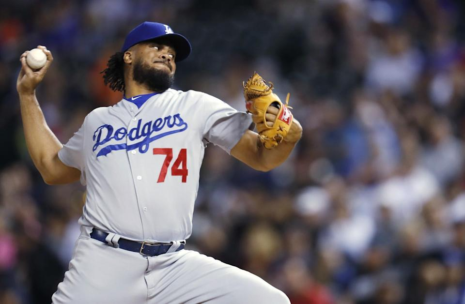 Los Angeles Dodgers reliever Kenley Jansen throws to a Colorado Rockies batter during the ninth inning of a baseball game Friday, May 12, 2017, in Denver.