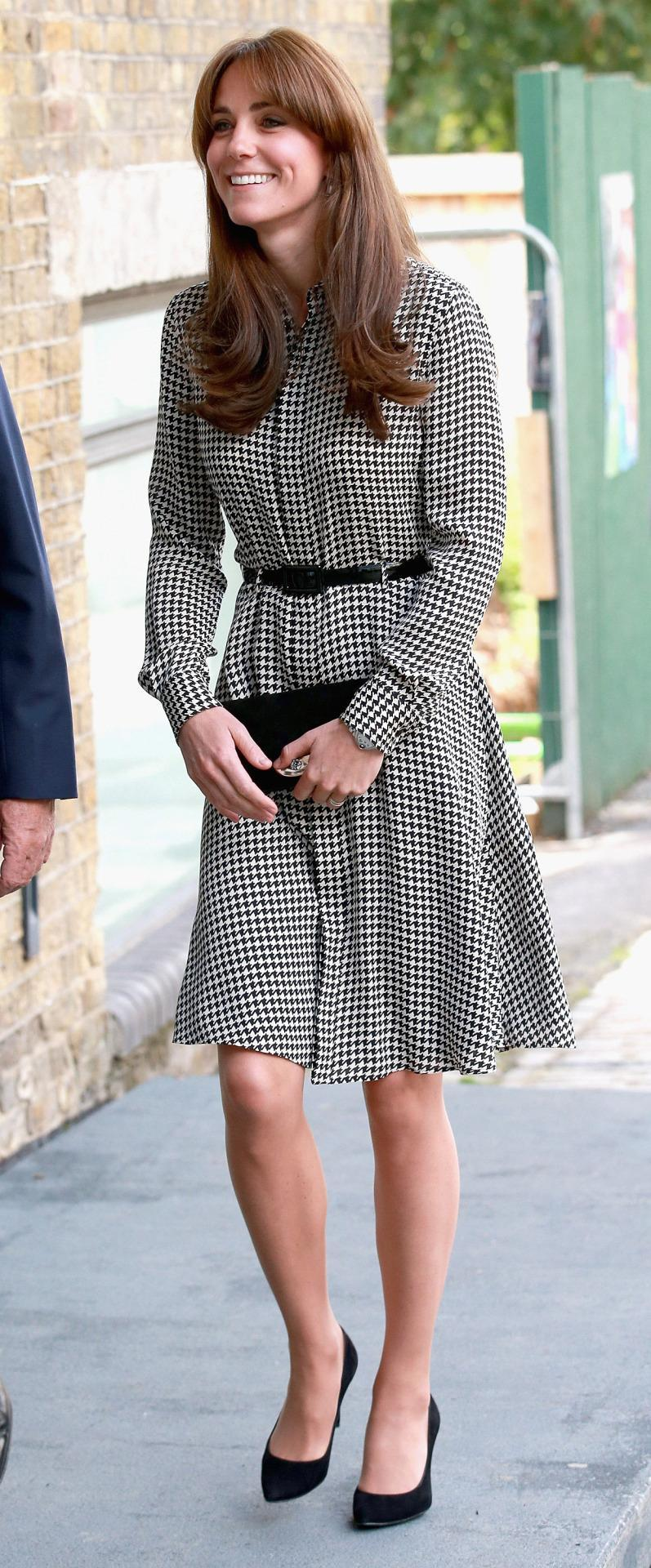 <p>Kate donned a houndstooth Ralph Lauren shirtdress for her first charity engagement after giving birth to Princess Charlotte. She accessorised with Stuart Weitzman pumps and a black Mulberry clutch. </p><p><i>[Photo: PA]</i></p>