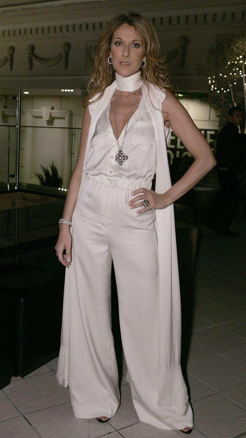 <p>In a silky white jumpsuit and scarf while attending a fashion show in Las Vegas. </p>