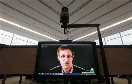 Accused government whistleblower Snowden is seen on a screen as he speaks via video conference with members of the Committee on legal Affairs and Human Rights of the Parliamentary Assembly of the Council of Europe in Strasbourg