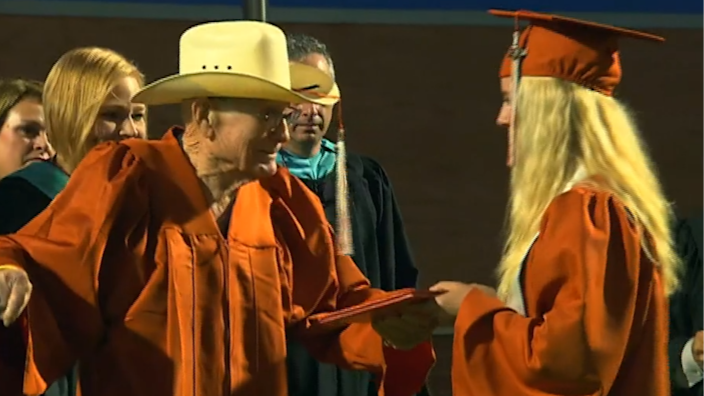 Pat Moore and his great-granddaughter Bryssa in their graduation gowns. / Credit: CBS News