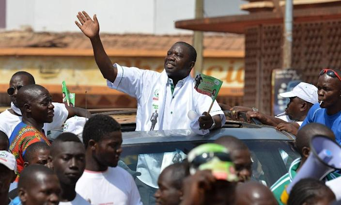 Central African Republic presidential candidate Agustin Agou waves to supporters during a campaign rally in Bangui (AFP Photo/Issouf Sanogo)
