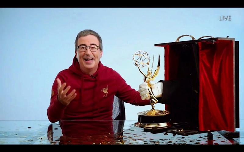 Talk show host John Oliver as he wins the Emmy for Outstanding Variety Talk Series - American Broadcasting Companies