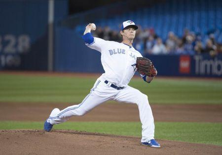 Apr 13, 2019; Toronto, Ontario, CAN; Toronto Blue Jays starting pitcher Clay Buchholz (36) throws a pitch during the first inning against the Tampa Bay Rays at Rogers Centre. Mandatory Credit: Nick Turchiaro-USA TODAY Sports