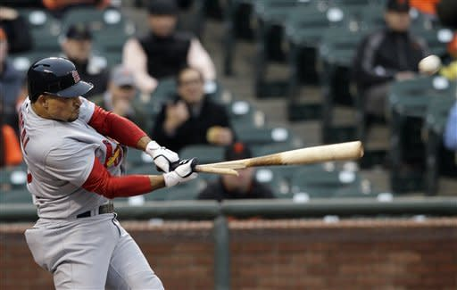 St. Louis Cardinals' Rafael Furcal breaks his bat on a single off San Francisco Giants pitcher Madison Bumgarner during the first inning of a baseball game in San Francisco, Wednesday, May 16, 2012. (AP Photo/Jeff Chiu)