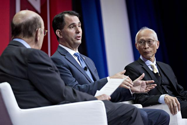 Scott Walker, governor of Wisconsin, center, Louis Woo, special assistant to the chairman of Foxconn Technology Group, right, and Wilbur Ross, U.S. commerce secretary, speaks at a panel at the SelectUSA Investment Summit on June 21, 2018. (Andrew Harrer/Bloomberg)