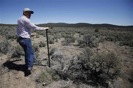 Cattle rancher Jeremy Hunt looks out over land, at a barbed wire fence in the Nephi Wash area outside Enterprise, Utah, April 10, 2014. REUTERS/Jim Urquhart