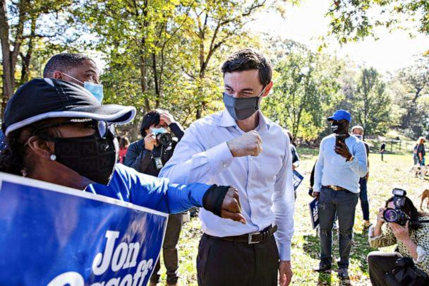 PHOTO: A supporter elbow bumps with Democratic U.S. Senate candidate Jon Ossoff after he spoke at a news conference in Grant Park after the election in Atlanta, Nov. 6, 2020. (Dustin Chambers/Reuters)
