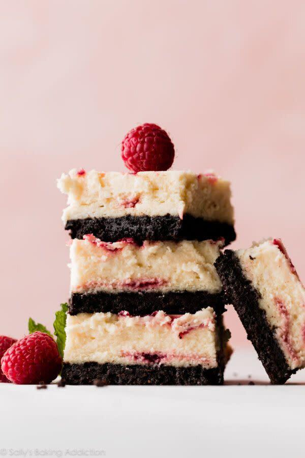 "<a href=""https://sallysbakingaddiction.com/white-chocolate-raspberry-cheesecake-bars/"" rel=""nofollow noopener"" target=""_blank"" data-ylk=""slk:Get the White Chocolate Raspberry Cheesecake Bars recipe from Sally's Baking Addiction"" class=""link rapid-noclick-resp""><strong>Get the White Chocolate Raspberry Cheesecake Bars recipe from Sally's Baking Addiction</strong></a>"