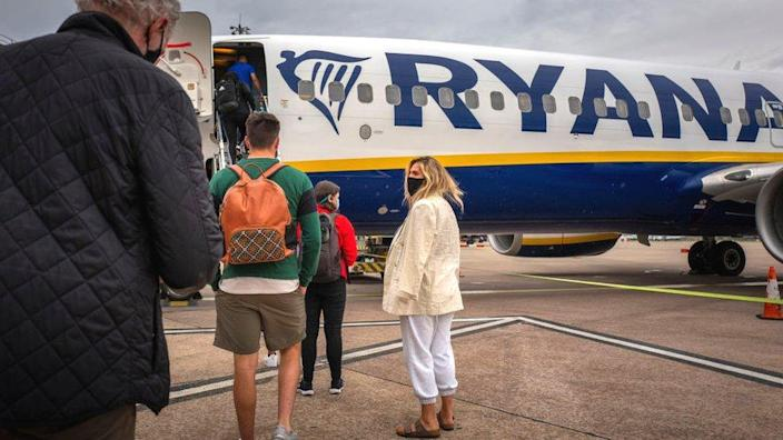 People boarding a Ryanair plane from City Airport, Manchester