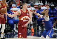 Denver Nuggets center Nikola Jokic (15) looks to pass the ball as New York Knicks center Taj Gibson defends in the second half of an NBA basketball game Wednesday, May 5, 2021, in Denver. (AP Photo/David Zalubowski)