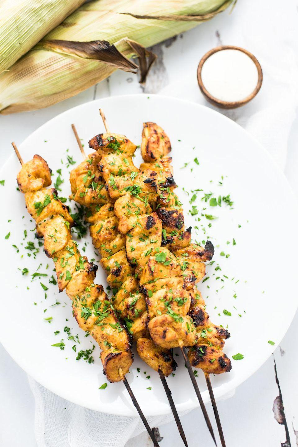 """<p>These flavorful curry chicken skewers could be a starter or a main dish at your dinner party served over a bed of rice.</p><p><strong>Get the recipe at <a href=""""http://cookingandbeer.com/2016/06/grilled-mango-curry-chicken-skewers/"""" rel=""""nofollow noopener"""" target=""""_blank"""" data-ylk=""""slk:Cooking and Beer"""" class=""""link rapid-noclick-resp"""">Cooking and Beer</a>.</strong> </p>"""