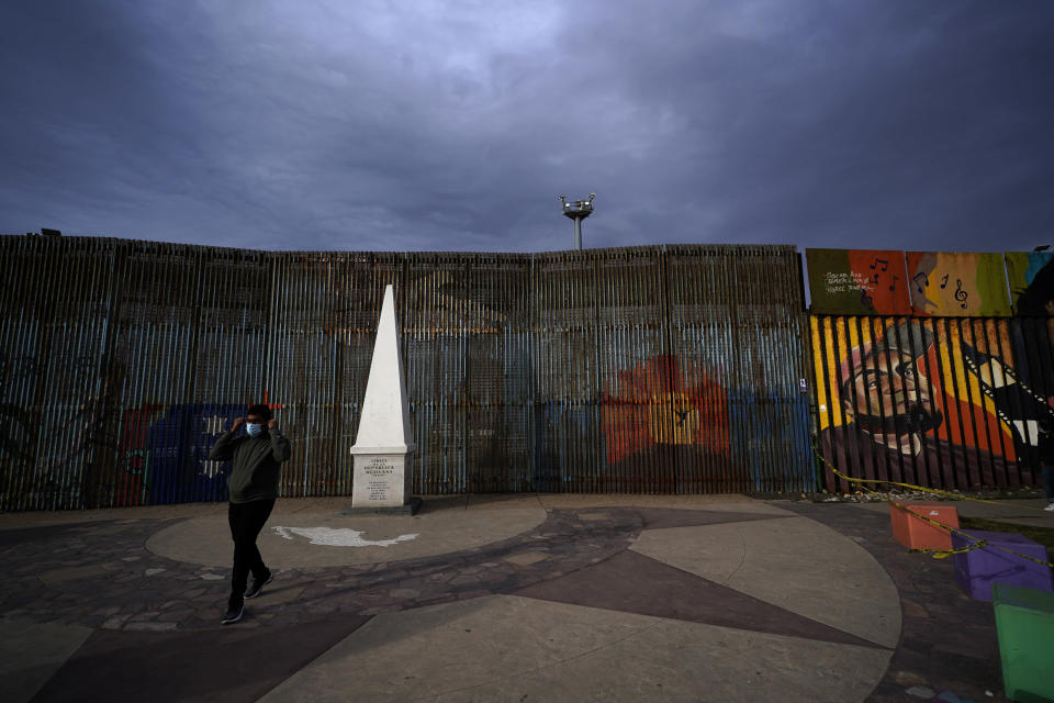 A man passes at Friendship Park, near where the border separating Tijuana, Mexico, and San Diego meets the Pacific Ocean Tuesday, Jan. 19, 2021, in Tijuana, Mexico. In the days before Joe Biden became president, construction crews worked quickly to finish Donald Trump's wall at an iconic cross-border park overlooking the Pacific Ocean that then-first lady Pat Nixon inaugurated in 1971 as symbol of international friendship. (AP Photo/Gregory Bull)