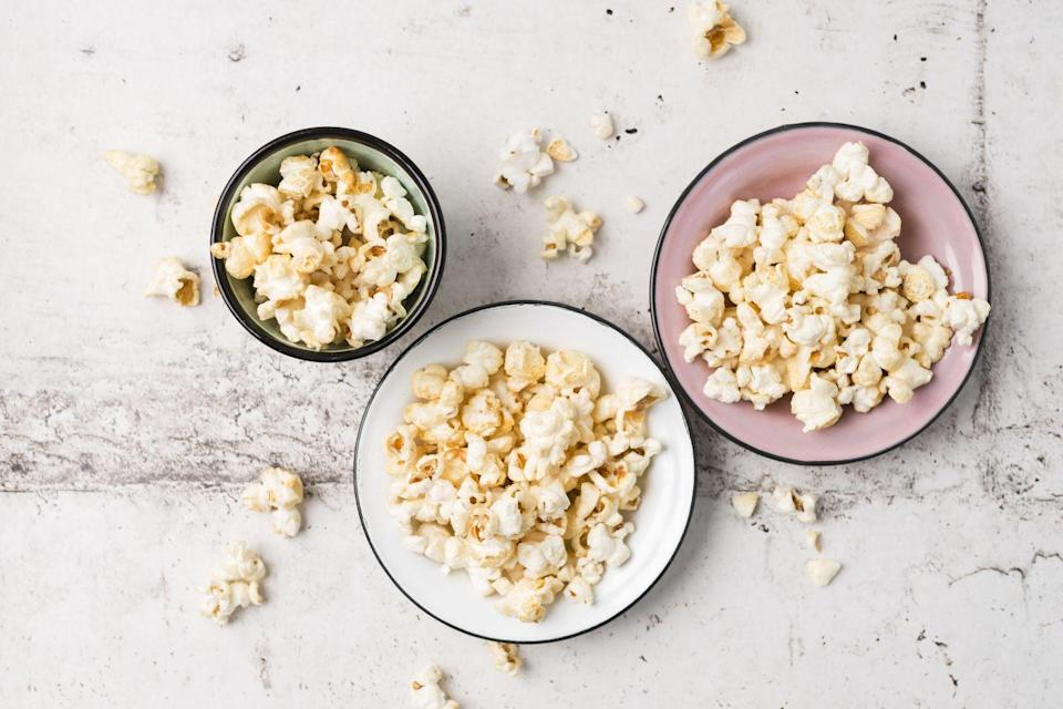 "<p>""Popcorn is very low in calories yet high in fiber, making it one of the best weight loss-friendly snacks available,"" says Dr. Axe. ""Instead of opting for microwave bags laden with chemicals and unhealthy additives, try making your own at home. Air-popped popcorn is easy to make and can be seasoned with ingredients like garlic powder, cayenne pepper or nutritional yeast to bump up the health benefits."" For a little more guidance, try this <a href=""https://www.prevention.com/food-nutrition/recipes/a20530460/garlic-chili-popcorn/"" rel=""nofollow noopener"" target=""_blank"" data-ylk=""slk:Garlic Chili Popcorn"" class=""link rapid-noclick-resp"">Garlic Chili Popcorn</a> recipe.</p>"