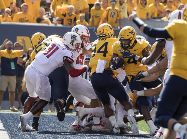 West Virginia running back Leddie Brown (4) runs for a touchdown during the second half of an NCAA college football game against North Carolina State Saturday, Sept. 14, 2019, in Morgantown, W.Va. (AP Photo/Raymond Thompson)