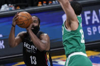 Boston Celtics forward Grant Williams (12) defends as Brooklyn Nets guard James Harden (13) shoots during the second half of Game 2 of an NBA basketball first-round playoff series Tuesday, May 25, 2021, in New York. (AP Photo/Kathy Willens)