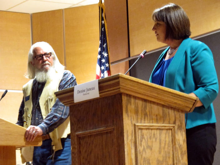 In this Oct. 5, 2016, photo, Libertarian Party candidate Rick Breckenridge, left, looks on during a debate with Democratic U.S. House candidate Denise Juneau in Great Falls, Montana. Breckenridge, who is running for U.S. Senate this year, endorsed Republican candidate Matt Rosendale in his race in response to an anonymous mailer that seeks to undermine conservative support of Rosendale. Rosendale is in a tight race against two-term Democratic Sen. Jon Tester. The mailer is reminiscent of tactics used by Democratic-friendly groups in Tester's 2012 race to promote the Libertarian candidate and peel away Republican voters. (AP Photo/Matt Volz)