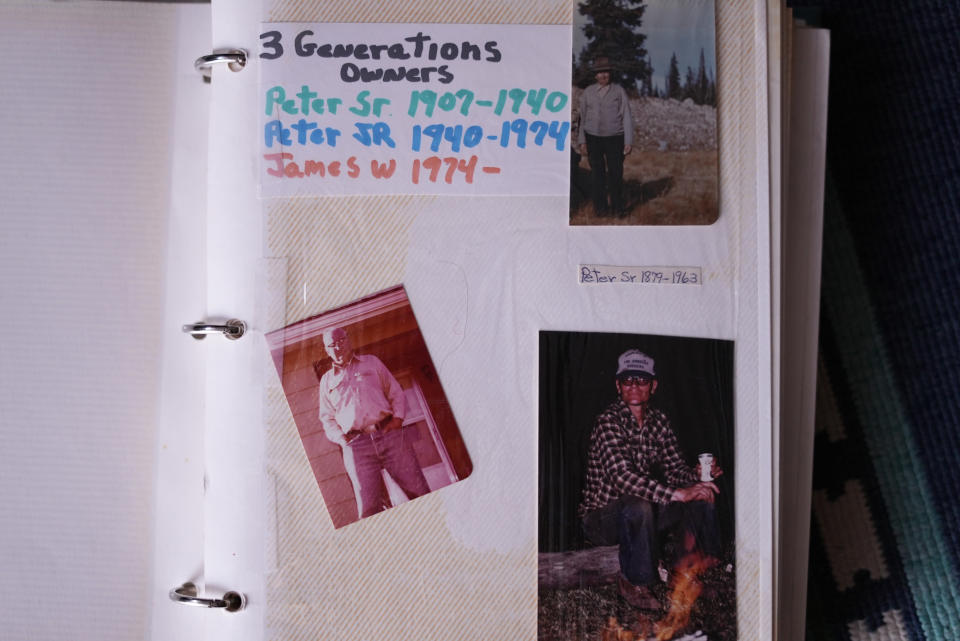 Three generations of ranch owners are shown in a family photo album, Wednesday, July 14, 2021, at the Stanko Ranch near Steamboat Springs, Colo. Peter Stanko Sr., top right, started the ranch in 1907 as a grain operation, then his son Peter Stanko Jr., bottom left, moved to dairy and beef cattle, and currently, Jim Stanko, bottom right, runs it as a cow-calf beef cattle operation. Jim Stanko says due to drought conditions this year, if his family can't harvest enough hay to feed their cattle, they may need to sell off some of their herd. (AP Photo/Brittany Peterson)