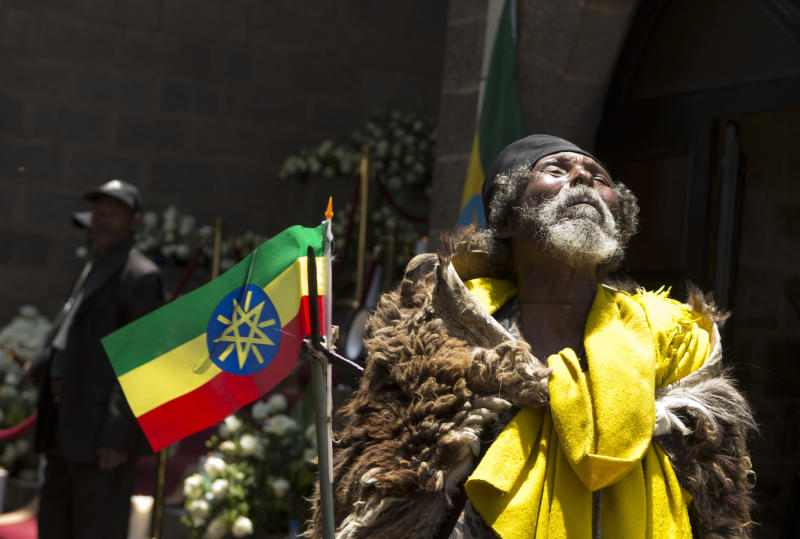 A holy man from northern Ethiopia chants out a poem toward the sky as his pays his respects to the body of late Prime Minister Meles Zenawi, at the national palace in Addis Ababa, Ethiopia Saturday, Sept. 1, 2012. Zenawi will be buried on Sunday.(AP Photo/Rebecca Blackwell)