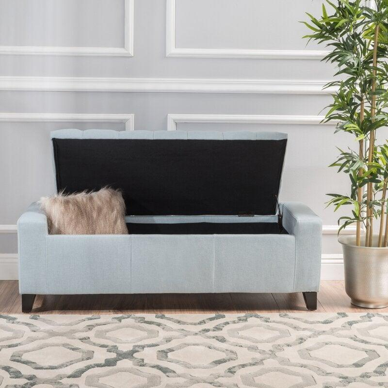 """<h2>AllModern Loni Upholstered Flip Top Storage Bench</h2><br>Use your bench/footstool/chair to its fullest potential and stuff it with linens, blankets, and other items you're not *totally* certain where to hide. <br><br><strong>AllModern</strong> Loni Upholstered Flip Top Storage Bench, $, available at <a href=""""https://go.skimresources.com/?id=30283X879131&url=https%3A%2F%2Fwww.allmodern.com%2Ffurniture%2Fpdp%2Floni-upholstered-flip-top-storage-bench-a001062246.html"""" rel=""""nofollow noopener"""" target=""""_blank"""" data-ylk=""""slk:AllModern"""" class=""""link rapid-noclick-resp"""">AllModern</a>"""