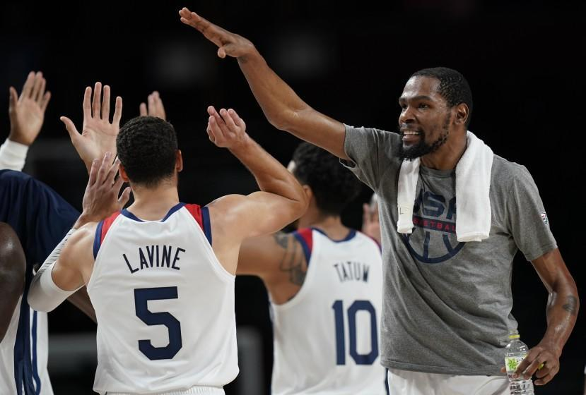 United States' Kevin Durant (7), right, celebrates with teammates.