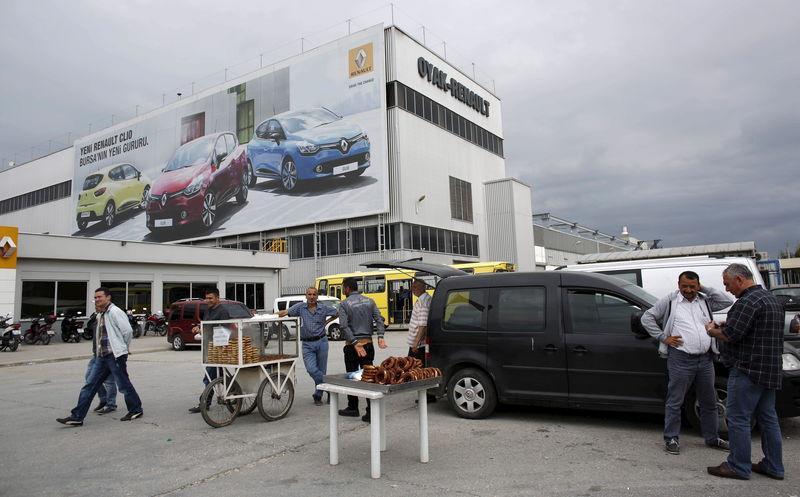 People stand in front of Renault car plant in Bursa, Turkey