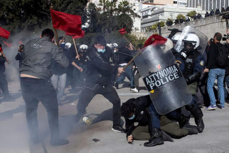 Greek university students clash with riot police during a demonstration against government plans to set up university police, amid the coronavirus disease (COVID-19) pandemic, in Athens
