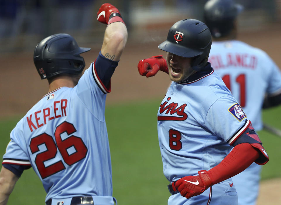 Minnesota Twins' Mitch Garver (8) celebrates with Max Kepler (26) after Garver hit a home run against the Texas Rangers during the second inning of a baseball game Wednesday, May 5, 2021, in Minneapolis. (AP Photo/Stacy Bengs)