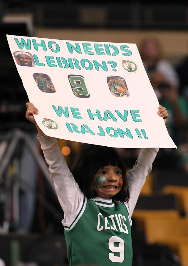 "BOSTON, MA - JUNE 03: A young fan holds up a sign which reads ""Who needs LeBron we have Rajon!"" prior to the Boston Celtics playing against the Miami Heat in Game Four of the Eastern Conference Finals in the 2012 NBA Playoffs on June 3, 2012 at TD Garden in Boston, Massachusetts. NOTE TO USER: User expressly acknowledges and agrees that, by downloading and or using this photograph, User is consenting to the terms and conditions of the Getty Images License Agreement. (Photo by Jim Rogash/Getty Images)"