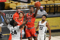 Auburn guard Allen Flanigan, center, shoots as he gets between Central Florida guards Dre Fuller Jr. (24) and Darin Green Jr., right, during the second half of an NCAA college basketball game, Monday, Nov. 30, 2020, in Orlando, Fla. (AP Photo/John Raoux)