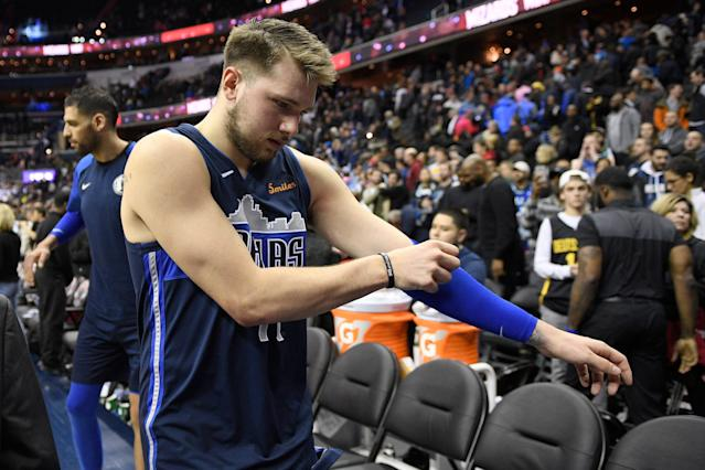 "Dallas rookie Luka Doncic felt a ""pop"" in his knee in the Mavericks' one-point loss to the Rockets on Sunday, something the team will take a closer look at on Monday. (AP/Nick Wass)"
