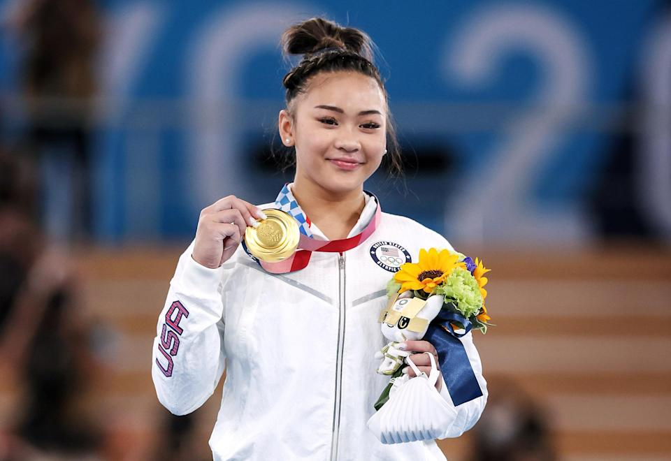 Image: Sunisa Lee of Team United States poses with her gold medal after winning the Women's All-Around Final on day six of the Tokyo Olympic Games at Ariake Gymnastics Centre on July 29, 2021. (Jamie Squire / Getty Images)