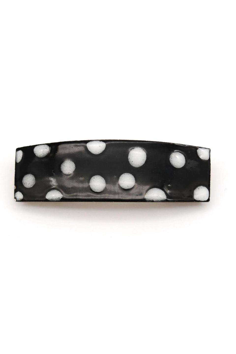 """<p><strong>Juice Ceramics</strong></p><p>juiceceramics.com</p><p><strong>$20.00</strong></p><p><a href=""""https://juiceceramics.com/collections/all/products/polka-dot-barrette"""" rel=""""nofollow noopener"""" target=""""_blank"""" data-ylk=""""slk:Shop Now"""" class=""""link rapid-noclick-resp"""">Shop Now</a></p><p>Juice Ceramics creates handmade accessories and home goods in St. Augustine Florida. This polka dot hair clip can be dressed up, or dressed down. Try it with a plain t-shirt or a casual dress for the biggest impact.</p>"""
