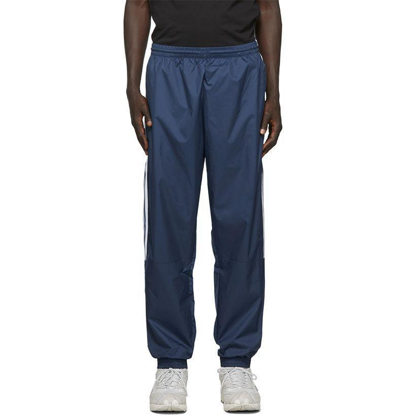 """<p><strong>Adidas Originals</strong></p><p>ssense.com</p><p><strong>$42.00</strong></p><p><a href=""""https://go.redirectingat.com?id=74968X1596630&url=https%3A%2F%2Fwww.ssense.com%2Fen-us%2Fmen%2Fproduct%2Fadidas-originals%2Fblue-lock-up-track-pants%2F4728791&sref=https%3A%2F%2Fwww.esquire.com%2Fstyle%2Fmens-fashion%2Fg33032327%2Fcheap-july-4-sales-mens-fashion%2F"""" rel=""""nofollow noopener"""" target=""""_blank"""" data-ylk=""""slk:Buy"""" class=""""link rapid-noclick-resp"""">Buy</a></p><p>A soccer hooligan classic in a perfectly slouchy fit. </p>"""