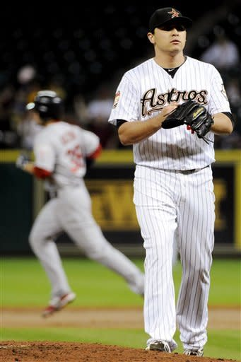 Houston Astros relief pitcher Fernando Rodriguez, right, looks off as St. Louis Cardinals' Pete Kozma, left, rounds the bases on a two-run home run in the second inning of a baseball game, Monday, Sept. 24, 2012, in Houston. (AP Photo/Pat Sullivan)