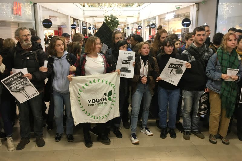 French activists protest the annual Black Friday shopping frenzy in Paris